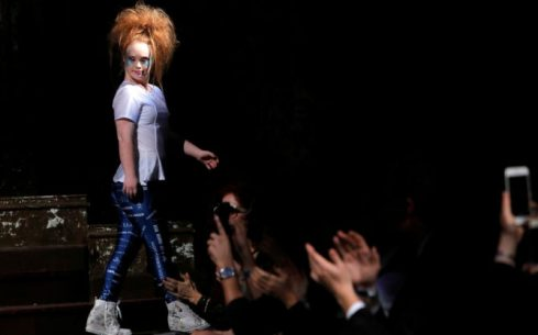 """Australian model and designer Madeline Stuart, who has Down syndrome, exits the runway after presenting creations from her label """"21 Reasons Why by Madeline Stuart"""" during New York Fashion Week in Manhattan. (Andrew Kelly/Reuters)"""